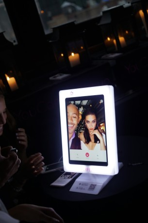 Sir John and Adriana Lima try the YouCam Makeup App.