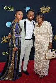 TRAVIS GREENE AND FAMILY